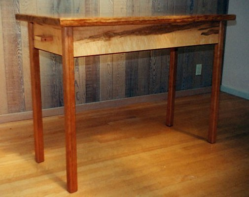 Entrance Table<br /> Uringa top, figured Maple sides and drawers, Cherry legs<br /> 50L x 24d x 30H
