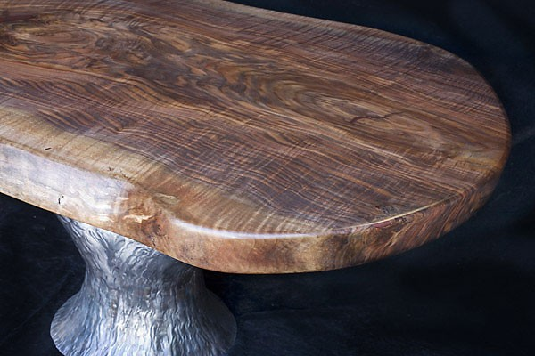 Tree of Life<br /> Figured California Walnut Table with Hammered, Forged Iron Tree Base<br /> 66L x 41W x 31H.