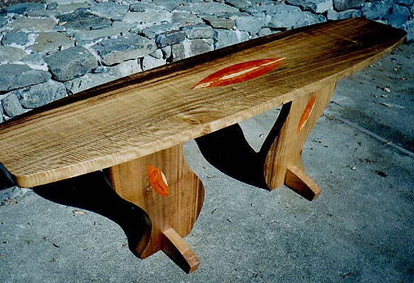 "Surf Table<br /> Tigered Myrtle with Pernamboca inlays & quilted Maple legs<br /> 19""W (tapered) x 84""L x 30""H<br /> $5500"