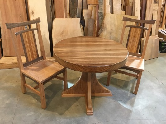 Breakfast set/  chairs- cherry and walnut with canary backs .  table is perota and red gum base .  table - 40 d x 30 h